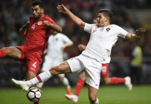 Tunisia's defender Yassine Meriah (L) challenges Portugal's forward Andre Silva during an international friendly football match between Portugal and Tunisia at the Municipal Stadium in Braga on May 28, 2018. / AFP PHOTO / MIGUEL RIOPA