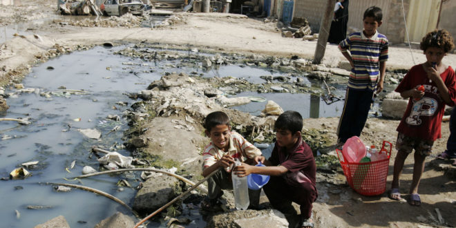 Iraqi boys fill a bottle from a broken pipe in the Shiite enclave of Sadr City in Baghdad, Iraq, Saturday, Sept. 13, 2008. Five people died in the latest Cholera outbreak in Iraq. Cholera is a waterborne gastrointestinal disease.  (AP Photo/Karim Kadim)